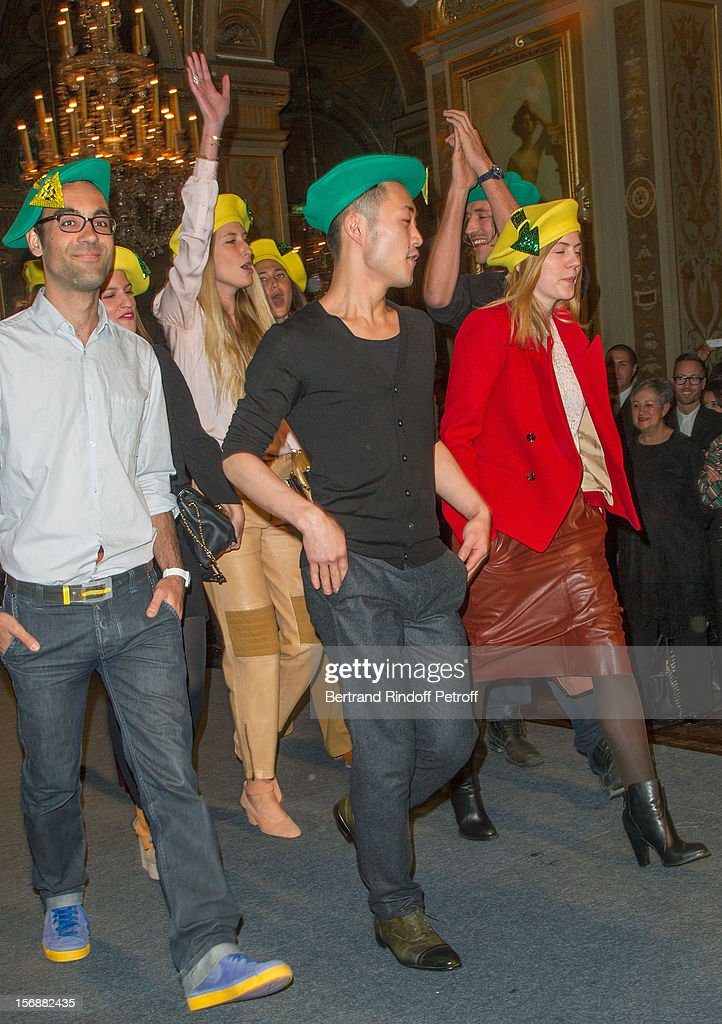 Young employees of the Chloe fashion house parade at the Paris City Hall during the Sainte-Catherine Celebration on November 23, 2012 in Paris, France.