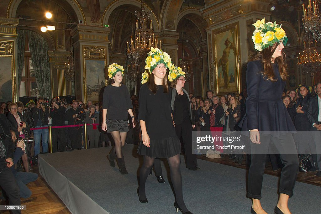 Young employees of the Christian Dior fashion house parade at the Paris City Hall during the Sainte-Catherine Celebration on November 23, 2012 in Paris, France.