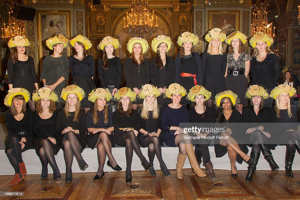 Young employees of the Hermes fashion house pose at the Paris City Hall during the Sainte-Catherine Celebration on November 23, 2012 in Paris, France.
