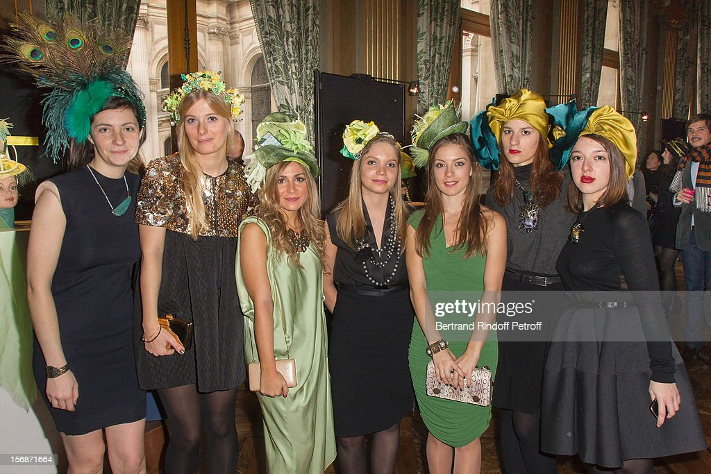 Young employees of the Lanvin fashion house pose at the Paris City Hall during the Sainte-Catherine Celebration on November 23, 2012 in Paris, France.