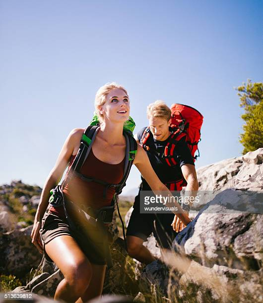 Young energetic hiker couple hiking on mountain in nature