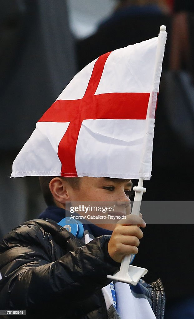 A young England fan waves a flag before the Cyprus cup final between England an France at GSP stadium on March 12, 2014 in Nicosia, Cyprus.