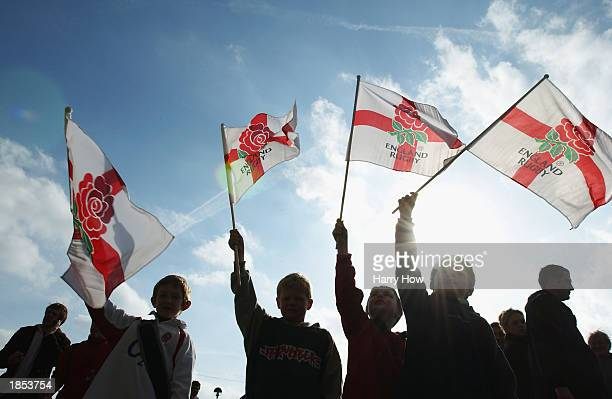 Young England fans wave their flags during the RBS Six Nations Championship match between England and Italy held on March 9 2003 at Twickenham in...