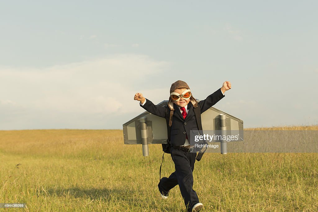 Young English Boy Dressed in Suit Wearing Jetpack : Stock Photo