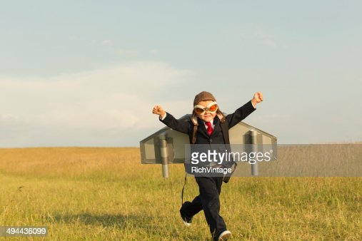 Young English Boy Dressed in Suit Wearing Jetpack