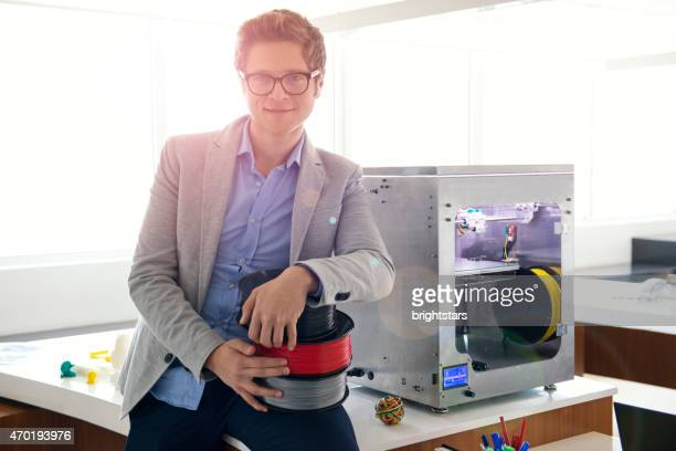 Young entrepreneur in a 3D printing office