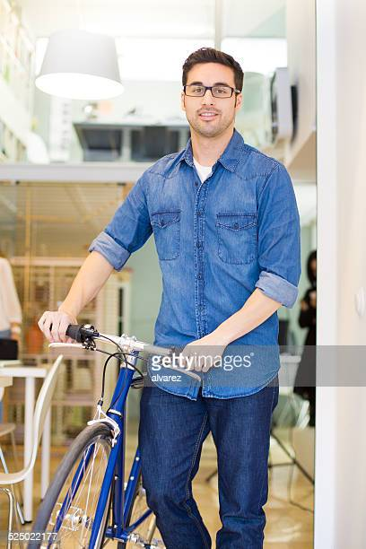 Young entrepreneur with his bicycle