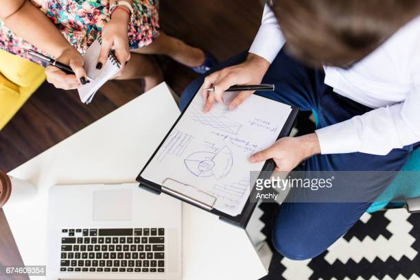 Young entrepreneur working with his assistant on a project
