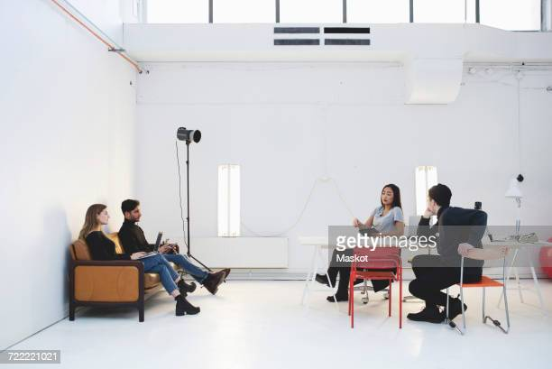 Young entrepreneurs discussing in creative office