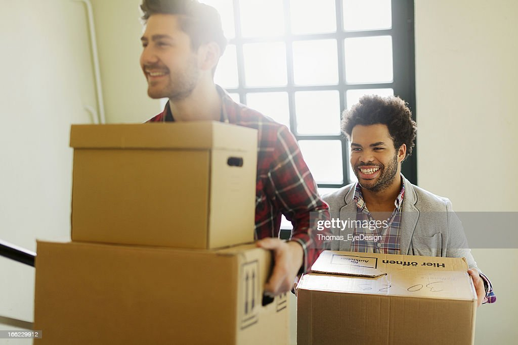 Young entrepreneurs moving into a new Office. : Stock Photo