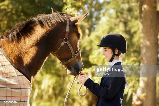 Young equestrian with her horse and best friend
