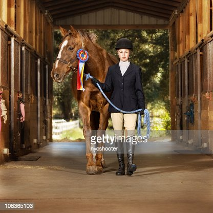 Young equestrian with her horse