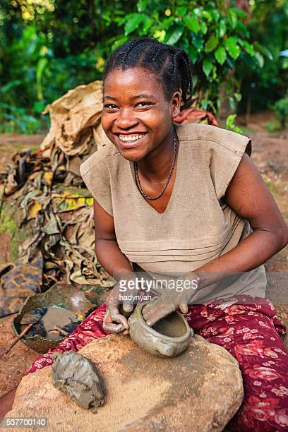 Young Ethiopian woman making pottery in Omo Valley