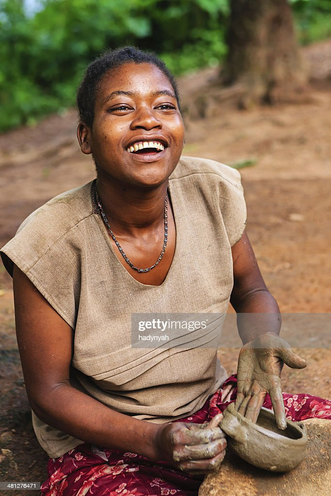 Young Ethiopian woman making pottery