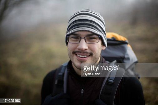 Young Ethnic Backpacker in the Woods