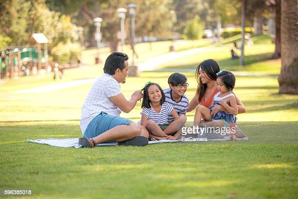 Young ethnic family laughing together