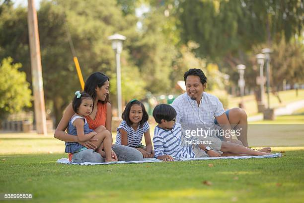 Young ethnic family with three children relaxing together