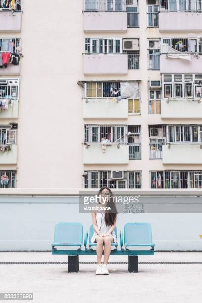 Young Eurasian Woman Sitting on Bench