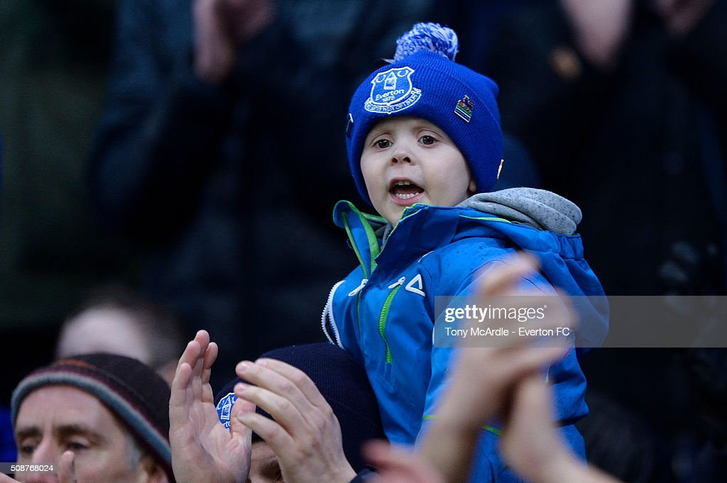 A young Everton fan cheers during the Barclays Premier League match between Stoke City v Everton at the Britannia Stadium on February 6, 2016 in Stoke on Trent, England.