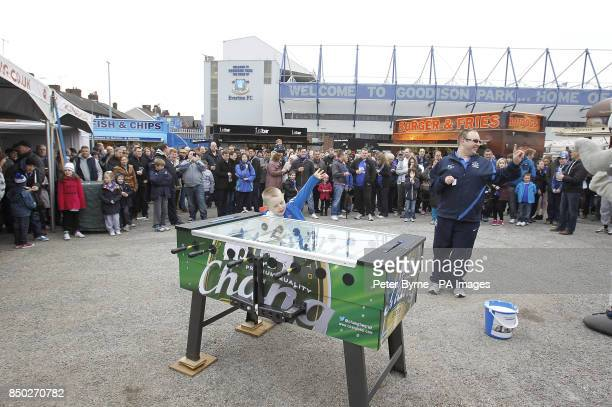A young Everton fan enjoys the Chang football table during the Everton Roadshow