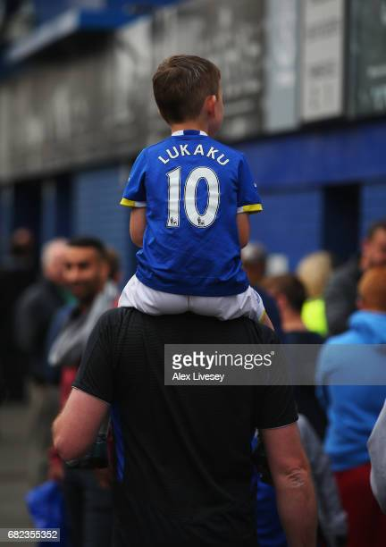 A young Everton fan gets a life to the ground prior to the Premier League match between Everton and Watford at Goodison Park on May 12 2017 in...