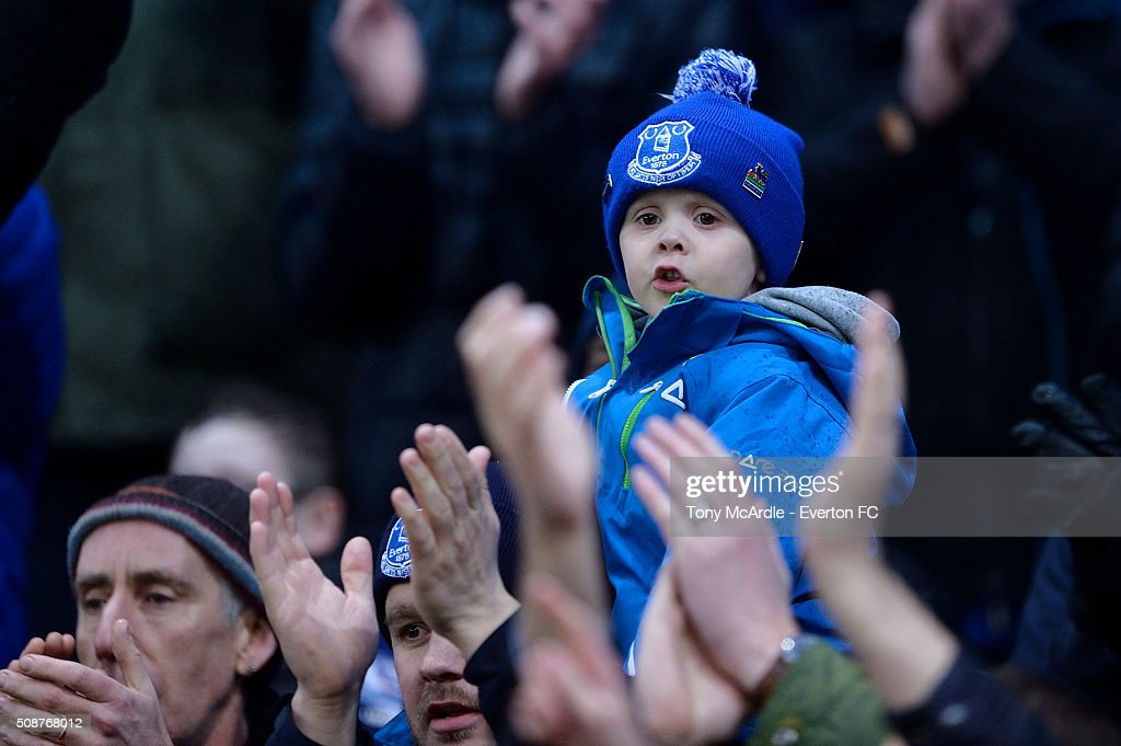 A young Everton fan looks on during the Barclays Premier League match between Stoke City v Everton at the Britannia Stadium on February 6, 2016 in Stoke on Trent, England.