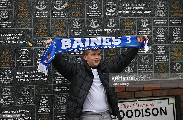 A young Everton fan shows his support outside Goodison Park prior to the Barclays Premier League match between Everton and Swansea City at Goodison...