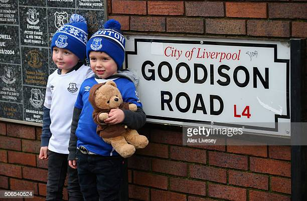 Young Everton fans stand next to the Goodison Road sign outside Goodison Park prior to the Barclays Premier League match between Everton and Swansea...