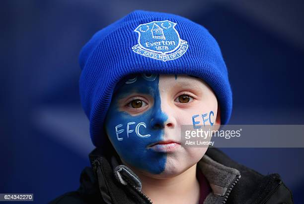 A young Everton supporter looks on prior to the Premier League match between Everton and Swansea City at Goodison Park on November 19 2016 in...