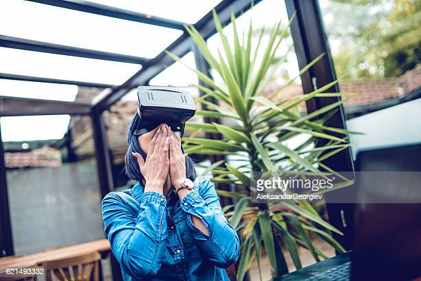 Young Excited Woman Having Fun with Virtual Reality Simulator