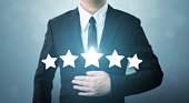 Young executive businessman in suit and five star symbol to increase rating of company, The excellence of the business or service concept
