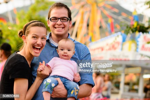 Young Family at the Fair : Stock Photo