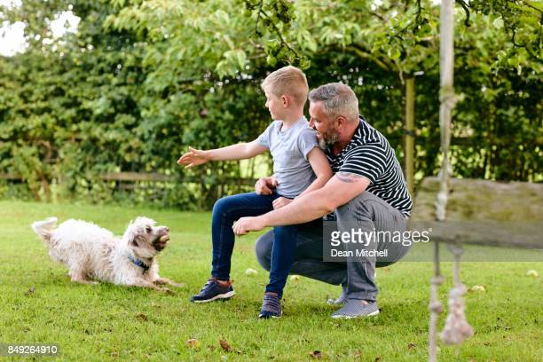 Young family at the park with pet dog