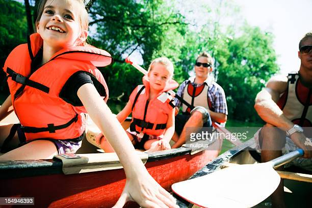 young family canoeing