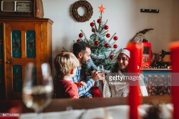 Young family celebrating Christmas together