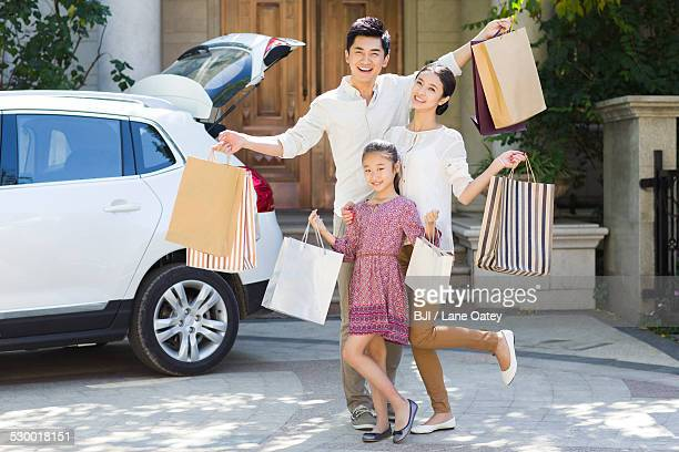 Young family coming back from shopping