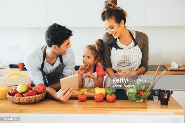 Young family cooking in the kitchen