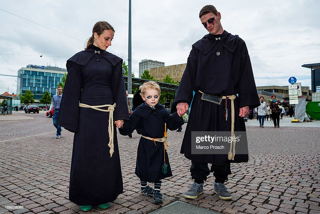 A young family dressed in black attends the second day of the annual Wave-Gotik Treffen, or Wave and Goth Festival, on May 18, 2013 in Leipzig, Germany. The four-day festival, in which elaborate fashion is a must, brings together over 20,000 Wave, Goth and steam punk enthusiasts from all over the world for concerts, readings, films, a Middle Ages market and workshops.