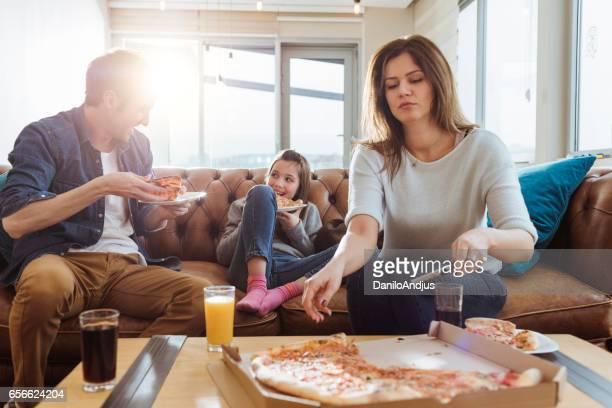 young family eating pizza for lunch