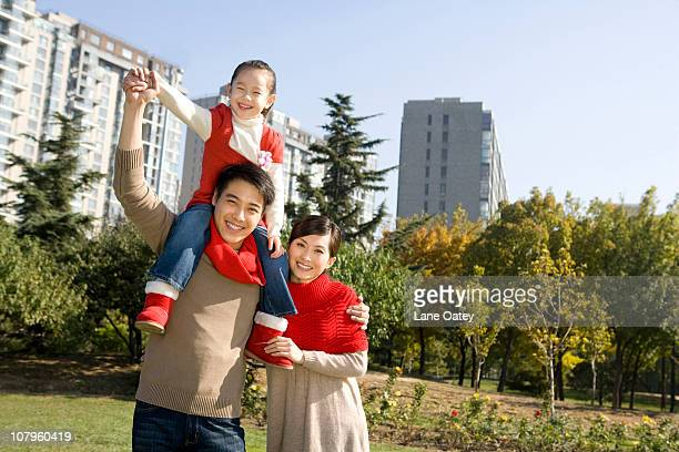 Young Family Enjoying a Park in Autumn