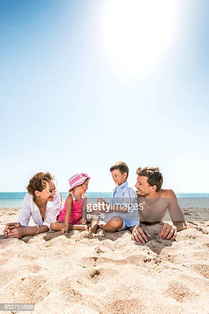 Young family enjoying at the beach.