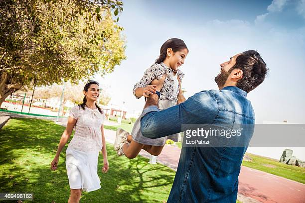 Young family enjoying life outdoor in a city park