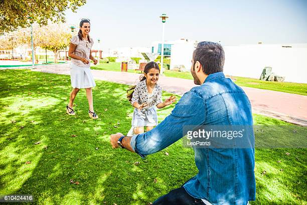 Young family enjoying sunday outdoor in a city park