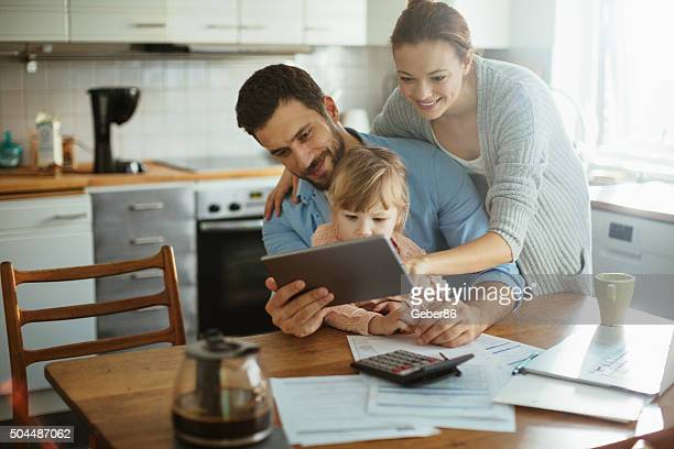 Young family enjoying time home