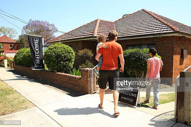 A young family enters a property during an open house inspection in the suburb of Willoughby in Sydney Australia on Saturday Oct 19 2013 Home prices...