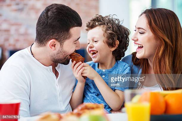 Young family having fun at breakfast