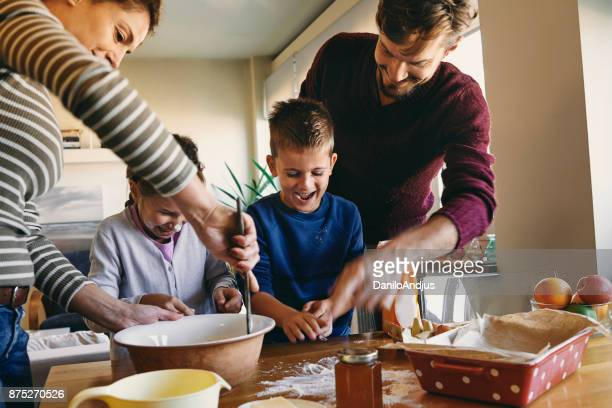 young family having fun baking together