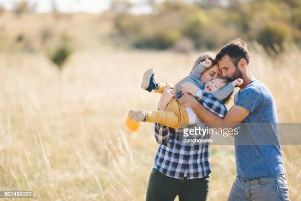 Young family in nature having fun