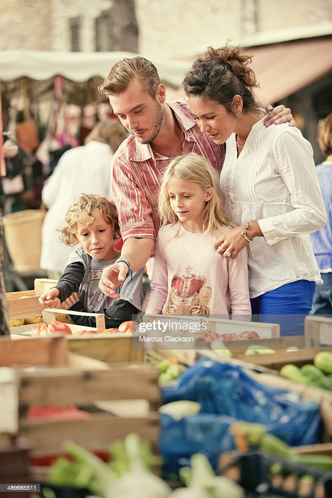 Young family in the market in Tourrettes Sur Loup. : Photo