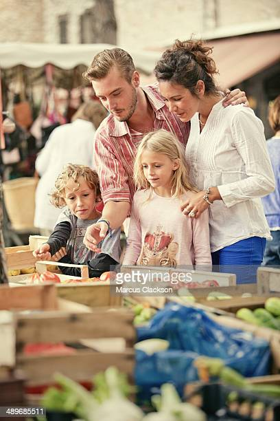 Young family in the market in Tourrettes Sur Loup.